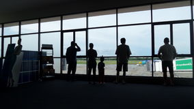 Silhouette people waiting airplane Royalty Free Stock Images
