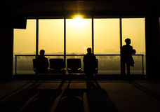 Silhouette of people waiting for departure from airport Stock Photos