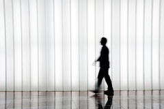Silhouette of people walking Stock Photos
