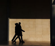 Silhouette of people walking Royalty Free Stock Photo