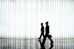Silhouette of people walking Stock Image