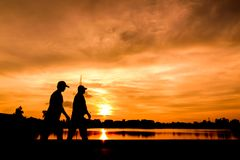 Silhouette of people walking stock photography