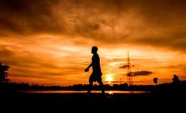 Silhouette of people walking stock image