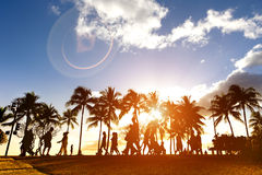 Silhouette of people walking at sunset on crowded Waikiki Royalty Free Stock Photo