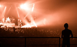 Silhouette of people, watching a band on stage Stock Image