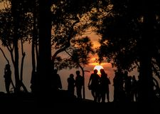 Silhouette people watching the sunset on the hilltop Stock Photos