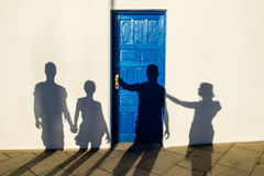 Silhouette of people on a white wall Royalty Free Stock Photo