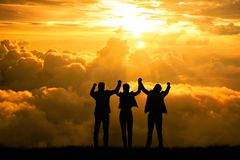 Silhouette people winning concept business team man and woman with arms up in the air for success goal concept. Silhouette people winning concept business team stock photo