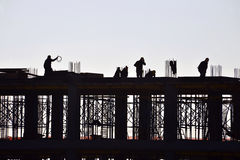 Silhouette of people working and building construction royalty free stock photos