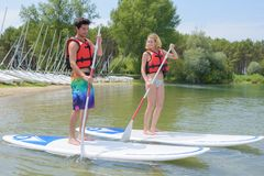 Silhouette perfect couple engage standup paddle boarding Stock Images