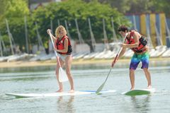 Silhouette perfect couple engage standup paddle boarding Stock Photos