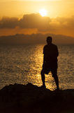 Silhouette of a person against sunset Royalty Free Stock Image