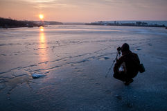 Silhouette of Person With Camera Tripod Stand Taking Photo of Sunset Royalty Free Stock Image