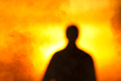 Silhouette   person   flame  fire  magical. The deformed silhouette of the person against fire of a smoke and bright sunrise Royalty Free Stock Photo