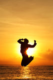 Silhouette of a Person Jumping Stock Photo