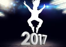 Silhouette of person jumping over 3D 2017 new year sign. Against digitally generated background Royalty Free Stock Photos