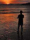 Silhouette of a person observing calm positive Sunset over sea in Thailand, Ao Nang beach, Krabi province Royalty Free Stock Photography