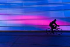 Silhouette of Person Riding on Commuter Bike Stock Images