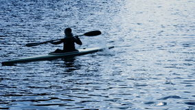 A silhouette of a person rowing a canoe.  stock video