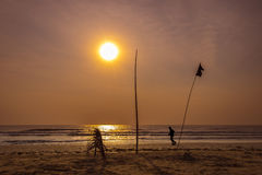 Silhouette of person running on beach against sunrise over the s Royalty Free Stock Images