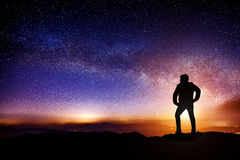 Silhouette a person is standing on mountains with Milky Way. Silhouette a person is standing on mountains with Milky Way galaxy Stock Photos