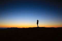 Silhouette of person at sunset Royalty Free Stock Photos