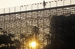 A silhouette of a person walking on the bleachers at the Toyota Grand Prix Race at the Indy Car World Series in Long Beach Califor Stock Photography