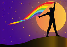 Silhouette person who keeps developing rainbow Stock Image