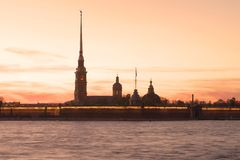 Silhouette of the Peter and Paul Cathedral on the background of the red May sunset. Saint Petersburg, Russia Stock Photos