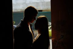 Silhouette photo. black faces.Close-up of kissing and embracing couples in old, doorway, family. date, attraction. Silhouette photo. black faces.Close-up of royalty free stock images