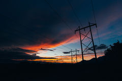 Silhouette Photo of a Electric Pole during Sunset Royalty Free Stock Image