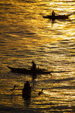 Silhouette photo. Fishermen catch fish at sunset. Beautiful suns Stock Photo