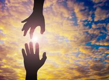 The Silhouette photo of hand to hand. royalty free stock photography