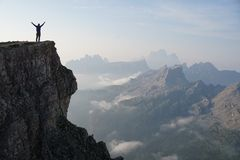 Silhouette Photo of a Man Standing on the Edge of the Mountain Stock Image