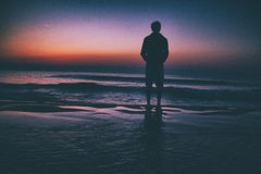 Silhouette Photo of Man Standing Near Seashore during Dawn Royalty Free Stock Photos