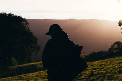 Silhouette Photo of Man during Sunset Royalty Free Stock Photography