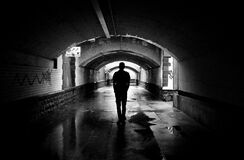 Silhouette Photo of a Man in a Tunnel Royalty Free Stock Photo