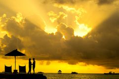 Silhouette Photo of Man and Woman Beside Body of Water during Sunset Royalty Free Stock Images