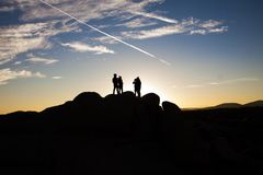 Silhouette Photo of People on Top of Rock Formation Royalty Free Stock Photos