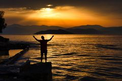 Silhouette Photo of Person Standing Near Beach Royalty Free Stock Images