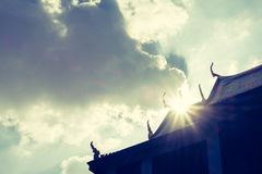 Silhouette photo of Thai fortress with sun beam over rooftop wit Royalty Free Stock Image