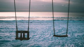 Silhouette Photo of Two Swings Royalty Free Stock Photos