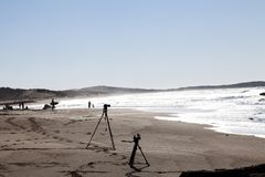 Silhouette Of Photo And Video Cameras On Tripods At Beach With Ocean royalty free stock photo