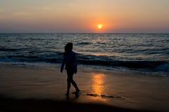 Silhouette photo of a woman walking on the beach. In Sri Lanka stock photo