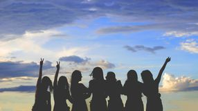 Silhouette Photo Of Women Under Blue Sky royalty free stock photo