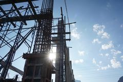 Silhouette photograph of concrete structure. During construction on blue sky background Stock Photo