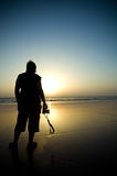 Silhouette of a photographer. Standing on a beach during sunset royalty free stock image
