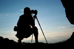 Silhouette of photographer Stock Photography