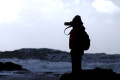 Silhouette of a photographer. Taken at the beach Stock Images