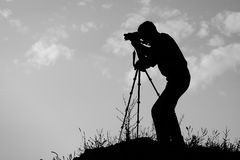 Silhouette of the photographer Stock Photo